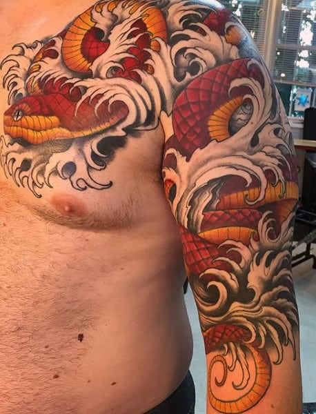 Snake Shoulder and Chest Tattoos